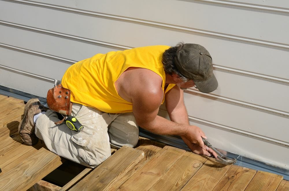 Instruction  and aluminum siding removal tool on the house